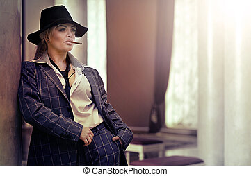 Portrait of a beautiful woman with cigarette posing