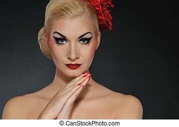 Portrait of a beautiful woman with creative make-up