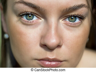 Portrait of a beautiful woman with green eyes. Selective focus on the eyes. Close-up.