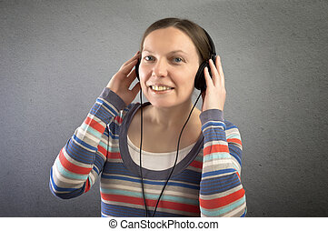Portrait of a beautiful woman with headphones.