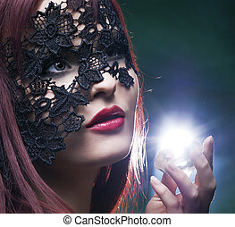 portrait of a beautiful woman with lace mask and  diamond