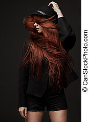 portrait of a beautiful woman with long red hair