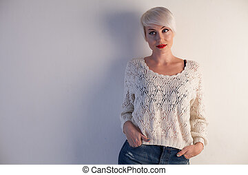 Portrait of a beautiful woman with short white hair