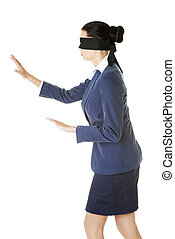 Portrait of a beautiful young blindfold businesswoman,...