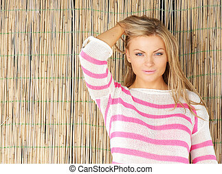 Portrait of a beautiful young blond woman with hand in hair