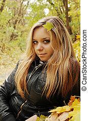 blonde lying on the foliage