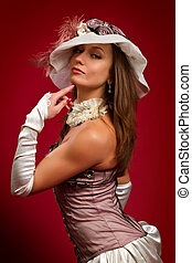 young brunette girl in a white hat