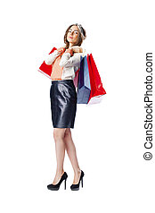 Portrait of a beautiful young brunette woman posing with shopping bags