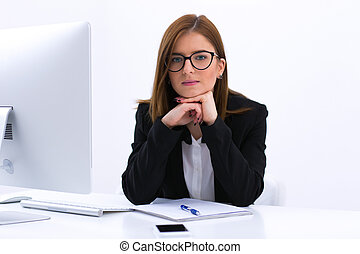 Portrait of a beautiful young businesswoman sitting at her workplace in office