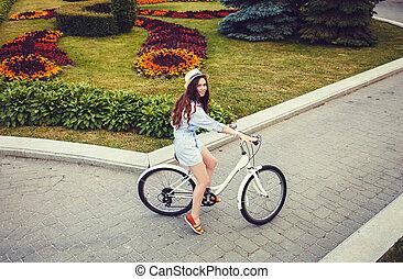 caucasian woman with her bike outdoor