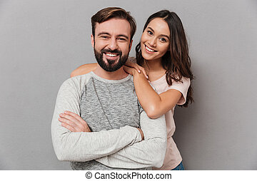 Portrait of a beautiful young couple hugging