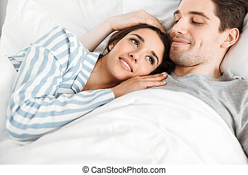 Portrait of a beautiful young couple lying together