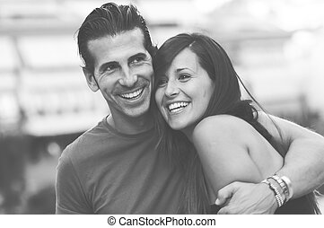 Portrait of a beautiful young couple smiling together
