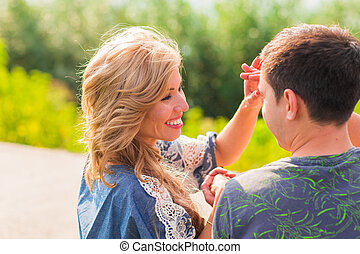 portrait of a beautiful young couple smiling together - Outdoor