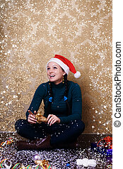 portrait of a beautiful young girl in a Christmas hat