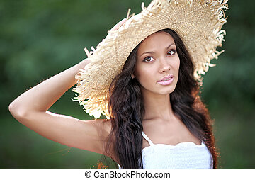 portrait of a beautiful young girl in summer