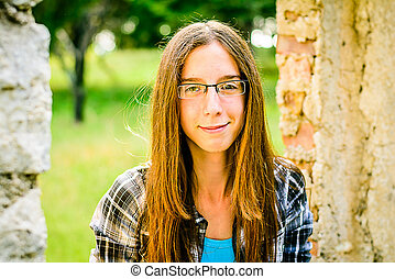Portrait of a beautiful young Girl in the Park