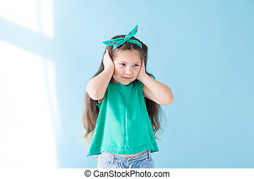 Portrait of a beautiful young girl sleep silence green clothing