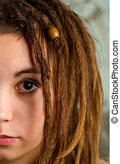 beautiful young girl with dreadlocks
