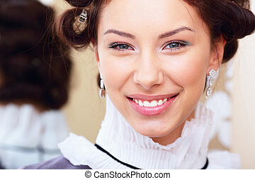 Portrait of a beautiful young happy lady. Retro style