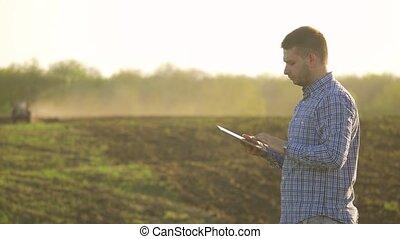 Portrait of a beautiful young man farmer student working in...