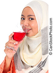 Portrait of a Beautiful Young Muslim Woman Smiling and Drinking a Glass of Water.