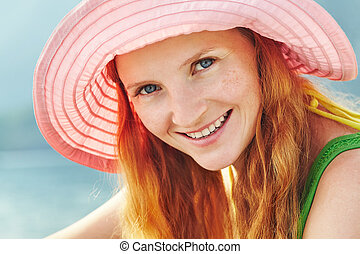 young relaxing woman in a hat