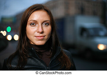 Portrait of a beautiful young woman at dusk. Shallow DOF, focus on eyes.