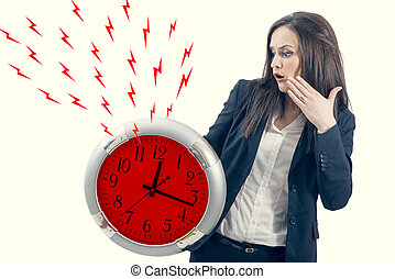 portrait of a beautiful young woman holding a big clock with red lightening bolt