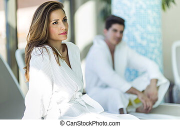 Portrait of a beautiful young woman in a bathrobe