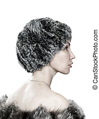 portrait of a beautiful young woman in a hat from a black and brown fox and a fur coat thrown over her bare shoulders