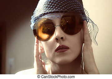 young woman in a retro sunglasses