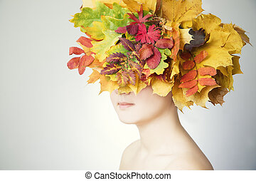 Portrait of a beautiful young woman in autumn