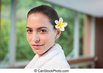 Portrait of a beautiful young woman in bathrobe