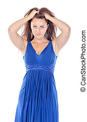 Portrait of a beautiful young woman in blue dress, holding on to her head on white background