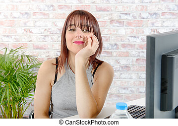 Portrait of a beautiful young woman in her office