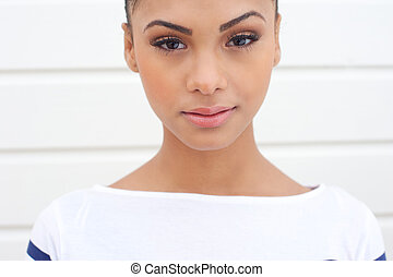 Portrait of a beautiful young woman looking at camera