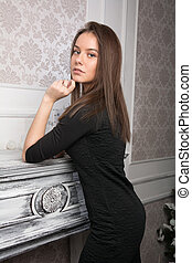 Portrait of a beautiful young woman near the dressing table