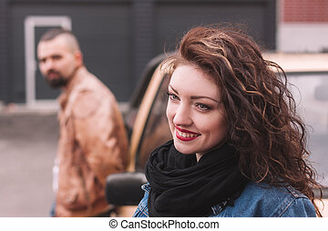 portrait of a beautiful young woman on the background of a modern city