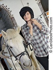 portrait of a beautiful young woman rider