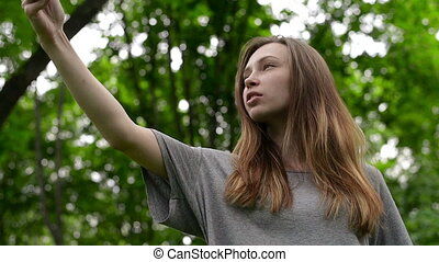 Portrait of a beautiful young woman, selfie in the street a smartphone