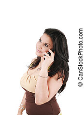 portrait of a beautiful young woman with cellphone against white background