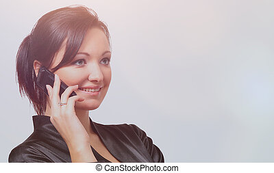 portrait of a beautiful young woman with cellphone against white background.