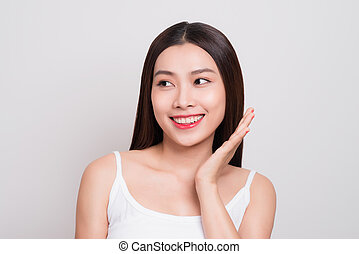Portrait of a beautiful young woman with clean skin