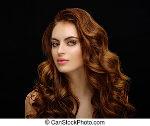 Portrait of a beautiful young woman with elegant long red shiny hair
