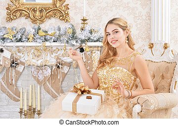 Portrait of a beautiful young woman with present