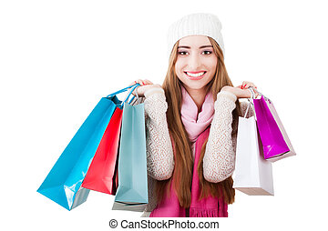 Portrait of a beautiful young woman with shopping bags.