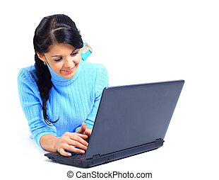 Portrait of a beautiful young woman with laptop over white background.