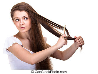portrait of a beautiful youth teen girl with comb isolated