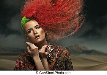 Portrait of a beauty woman on the desert